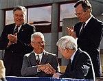 Admiral James Watkins Secretary of Energy, Joe Coors (President and Chairman of Coors Ceramics), Al Trivelpiece (Dir. of Oak Ridge National Lab.) and President George Bush Sr (7109354619).jpg