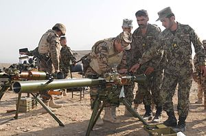 SPG-9 - A Mongolian Mobile Training Team member reviews the SPG-9 recoilless gun with Afghan National Army soldiers prior to a live-fire weapons demonstration, September 2, at the Camp Scenic weapons range near the Darulaman Infantry School in Kabul, Afghanistan. The MTT specialize in SPG-9 recoilless rifle systems and train ANA soldiers at the infantry school.