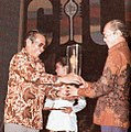 Ali Moertopo giving Citra to G Dwipayana, Festival Film Indonesia (1982), 1983, p68.jpg