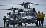 An MH-60S Sea Hawk helicopter prepares to take off from the flight deck. (36399192206).jpg