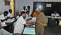 An old woman voter being administered indelible ink, at a polling booth, during the 6th Phase of General Elections-2014, in Tamil Nadu on April 24, 2014.jpg