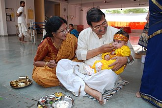 Sanskara (rite of passage) - Sanskaras are, in one context, the diverse rites of passage of a human being from conception to cremation, signifying milestones in an individual's journey of life in Hinduism. Above is annaprashan samskara celebrating a baby's first taste of solid food.