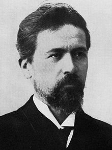 head and shoulders engraving of bearded Chekhov in pince-nez and suit