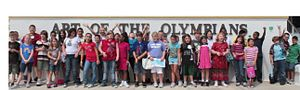 Art of the Olympians - A school class pose for a photo during an AOTO workshop break.