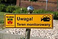 Area monitored sign Marki.JPG