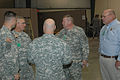 Army Brig. Gen. David R. Brown, assistant adjutant general, Alabama National Guard, greets visitors Art Faulkner, director of the Alabama Emergency Management Agency and Maj. Gen. Perry G. Smith, right, adjutant 120811-A-IW994-001.jpg