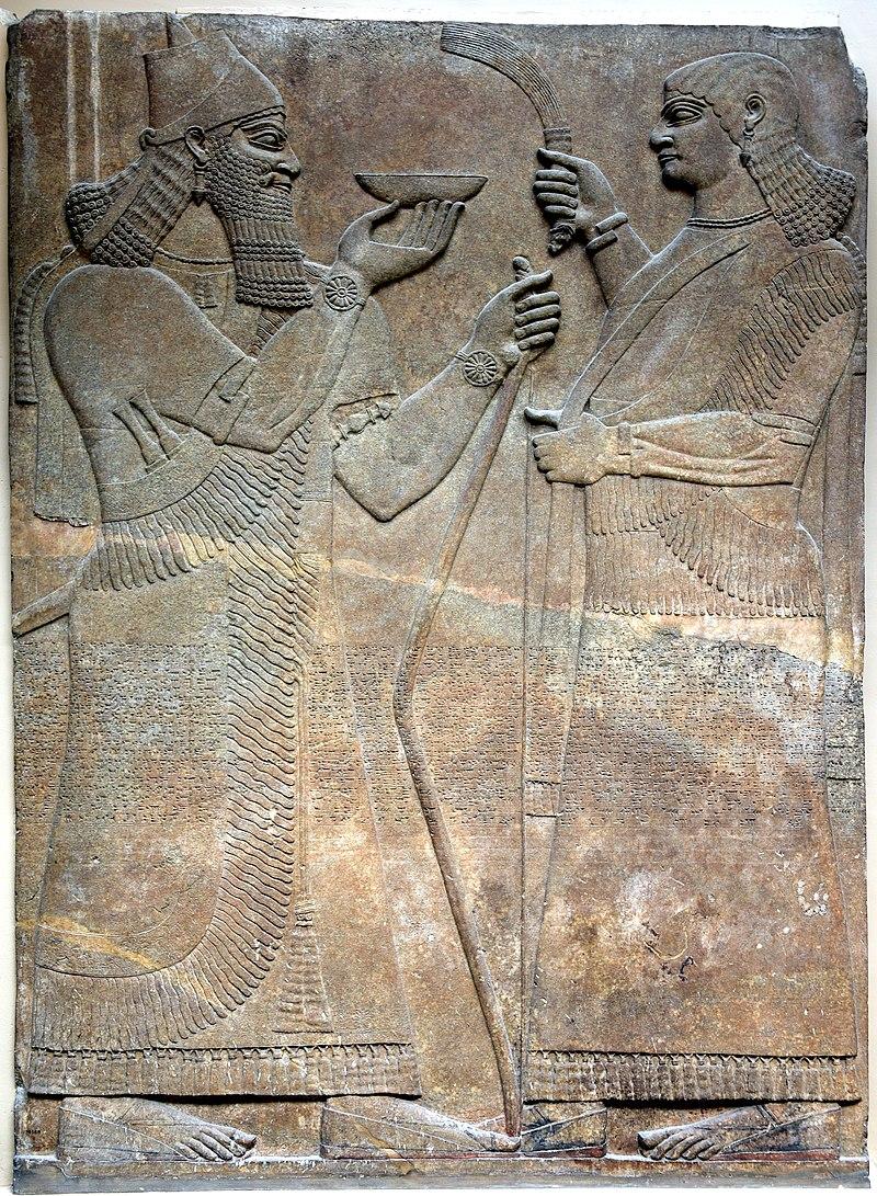 Ashurnasirpal II performs a religious ritual. From Nimrud, Iraq. 865-860 BCE. British Museum.jpg