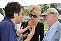 Atom Egoyan, Lynne St. David-Jewison and Norman Jewison at the 2012 CFC BBQ. (48198978067).jpg