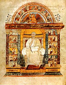 An illuminated manuscript illustration of a central seated figure holding an open book. He is flanked by two colonnades, which are filled with small scenes. Over the central figure is an arch which surmounts a winged bull.