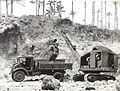 Australian Army power shovel unloading gravel into a truck at Jacquinot Bay in December 1944.JPG