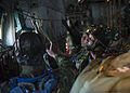 Bangladesh Air Force (BAF) paratroopers connect to a static line aboard a U.S. Air Force C-130 Hercules aircraft over Bangladesh during exercise Cope South 14 Nov. 10, 2013 131110-F-SI013-131.jpg