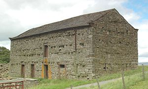 Bank barn - A bank barn near Barras, Cumbria (formerly Westmorland). The lower side of this example has four doorways, one now blocked, to different spaces for livestock