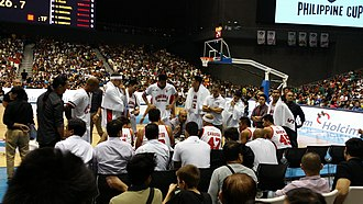 Barangay Ginebra San Miguel - Barangay Ginebra during one of their timeouts. Photo was taken during the 2014–15 Philippine Cup, when Jeffrey Cariaso was still the head coach of the team.