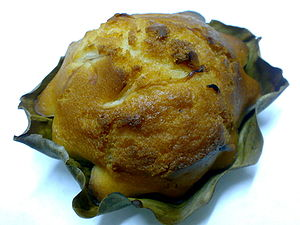 Bibingka - Commercial bibingka in banana leaf liner showing the distinctive notched edges