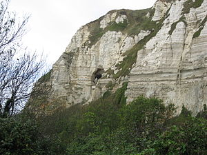 Beer Quarry Caves - Cliffs east of Branscombe, Devon, showing an adit to Beer Stone workings