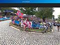 Ben King Rides Past His Fans (21151160793).jpg