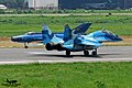 Bengal blues Bangladesh Air Force Fulcrum meets F-7BG at DAC (25632766452).jpg