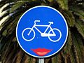 Bicycle lane sign with lipsticked mouth by Clet Abraham.jpg