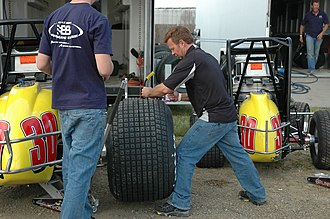 Billy Boat - Billy Boat (right) preparing tires for his son Chad's sprint car in 2007
