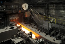 Hot bar of steel in a mill