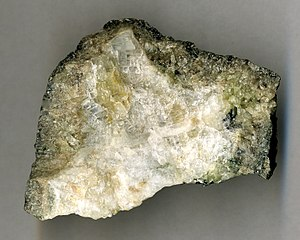 Bromellite - A yellowish crystal of bromellite