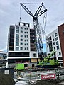 Building construction and crane in Leirvik, Stord, Norway (Veidekke Nordic Crane) 2018-03-06.jpg