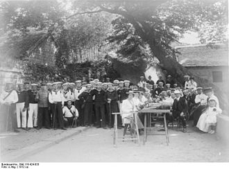 Jiaozhou Bay - German sailors posing with German colonial government officials and their families in Tsingtau (1912)
