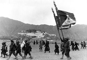Flag of Tibet - The Tibetan army waves the Tibetan flag at a military parade in Lhasa, 1938.