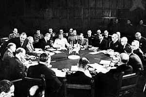 Potsdam Declaration - Potsdam Conference session including Clement Attlee, Ernest Bevin, Vyacheslav Mikhailovich Molotov, Joseph Stalin (white uniform), William D. Leahy, Joseph E. Davies, James F. Byrnes, and Harry S. Truman (right).