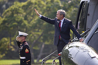 Domestic policy of the George W. Bush administration - President George W. Bush waves as he prepares to depart the White House aboard Marine One from the South Lawn en route to Andrews Air Force Base for his trip to Michigan.