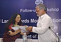 C.P. Joshi being welcomed by the Secretary, Department of Land Resources, Ministry of Rural Development, Smt. Rita Sinha, at the Follow-up Workshop on National Land Records Modernization Programme (NLRMP), in New Delhi.jpg