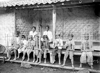 Angklung - Sundanese boys playing the Angklung in 1918.