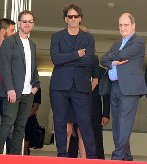2015 Cannes Film Festival - Ethan and Joel Coen, Main Jury Presidents, with Festival President Pierre Lescure.