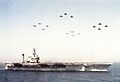 Carrier Air Wing 1 aircraft fly over USS America (CV-66) in 1991.jpg