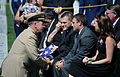 Chairman of the Joint Chiefs of Staff Navy Adm. Mike Mullen gives his condolences to Craig and Matt Wisniewski, brothers of U.S. Air Force Capt. David A. Wisniewski, during Capt. Wisniewski's internment 100823-F-JI436-007.jpg