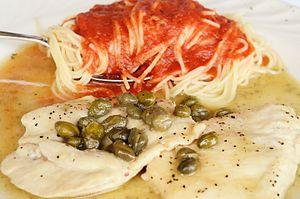 Piccata - Chicken piccata with a side of spaghetti