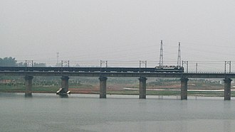 Jiaozuo–Liuzhou Railway - A freight train crossing the Yi River Bridge on the Jiaoliu Railway near Longmen in Luoyang.