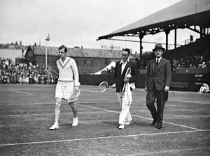 Christian Boussus - Christian Boussus (left) and Vivian McGrath (center) enter the center court of the White City Stadium in Sydney, Australia in November 1934