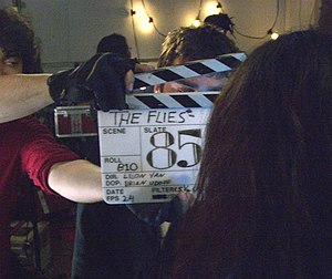 Clapperboard - An acrylic glass clapperboard in use