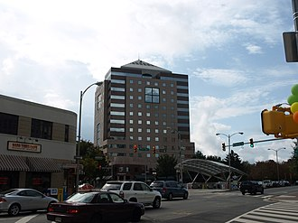 Clarendon, Arlington, Virginia - Intersection of Wilson Boulevard and N. Highland Street in Clarendon, with Clarendon Metro Station entrance and Olmsted Building in background (2008)