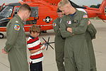 Coast Guard Air Station Traverse City crew reunites with rescued boy from Illinois 140729-G-PL299-096.jpg