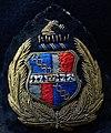 Coat of arms of Birmingham on a flat cap in West Mildlands Police Museum.jpg