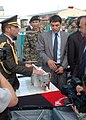 Col. Can Bolat explains to Minister Baz Mohammed Jawhari the type of sewing machines that have been donated (4699296527).jpg