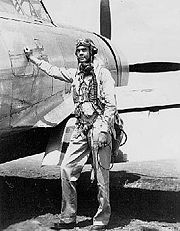 Col. Benjamin O. Davis, Jr., commander of the Tuskegee Airmen 332nd Fighter Group, in front of his P-47 Thunderbolt in Sicily.