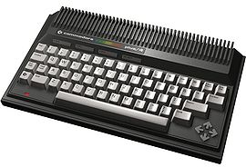 "Commodore Plus/4. Note the four arrow-shaped keys forming the cursor key ""diamond"" to the right."