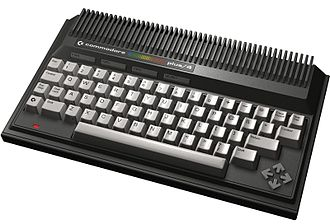 "Commodore Plus/4 - Commodore Plus/4. Note the four arrow-shaped keys forming the cursor key ""diamond"" to the right."