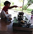 Cooking with love for the father, India.jpg