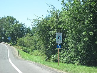Oregon State Scenic Byways - A sign for the Cottage Grove Covered Bridge Tour Route
