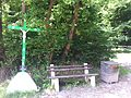 Cross and bench at Grunhaut forest.JPG