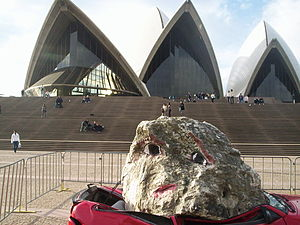 Biennale of Sydney - Sydney Biennale 2004 - Jimmie Durham's Still Life with Stone and Car in front of the Sydney Opera House